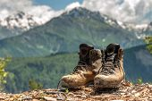 tourist boots and mountain on summer time