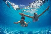 pic of sky diving  - Young couple underwater in the swimming pool - JPG