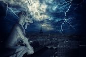 picture of gargoyles  - Gargoyle of Notre Dame de Paris Cathedral with lightnings  - JPG