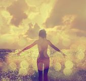 stock photo of open arms  - Beautiful Woman in Bikini Standing in the Sea Waves and Enjoying Sunshine with Open Arms - JPG