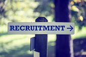 stock photo of recruiting  - Recruitment signboard on a wooden post with a right pointing arrow - JPG