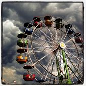 Instagram style image of Ferris Wheel with threatening storm clouds looming overhead