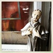 Instagram style image of a Catholic saint guarding a home window