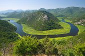 Crnojevica River flowing curved into Skadar Lake National Park, Montenegro