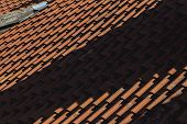 stock photo of red roof tile  - Nice red tiled roof with shadows of sun - JPG