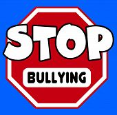 stock photo of stop bully  - A octagonal Stop sign in red and white with Bullying caption on a blue background - JPG
