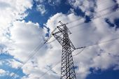 foto of electricity pylon  - The Electricity pylon against the blue sky - JPG