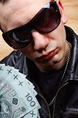 stock photo of stolen  - Chief boss mafia gangster thug with stolen polish money - JPG
