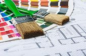 pic of interior decorator  - tools and accessories for home renovation on an architectural drawing - JPG