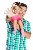 Father and his small daughter waving their hands and greeting at the camera (isolated on white)