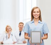 healthcare, technology, advertisement and medicine concept - smiling female doctor or nurse and tabl