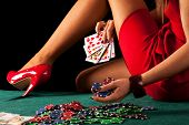 stock photo of gambler  - A sexy gambling woman with a poker royal flush - JPG
