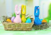 foto of ear candle  - Funny handmade Easter rabbits in wicker basket - JPG