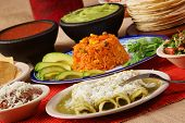 pic of enchiladas  - Stock image of traditional mexican food green enchilada dinner