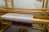 stock photo of loom  - Loom with a carpet showing how a loom is made - JPG