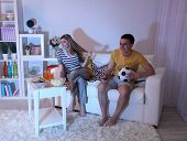 Young couple watching television at home of blacking-out