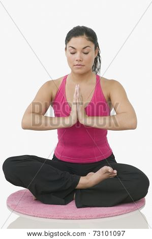 Teen girl meditating in a yoga position