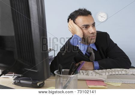 Stressed out businessman at his desk