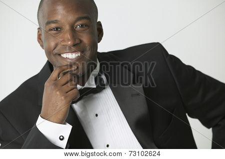 African American man wearing tuxedo