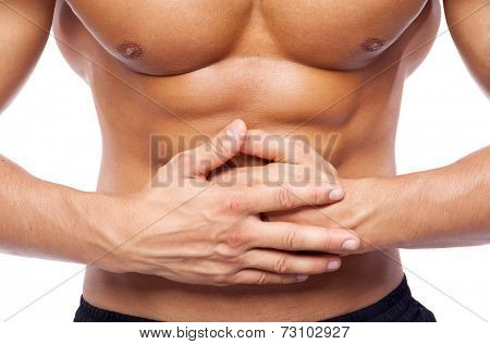 Young man holding his stomach in pain, isolated on white background