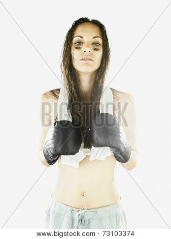 Female boxer threatening the camera
