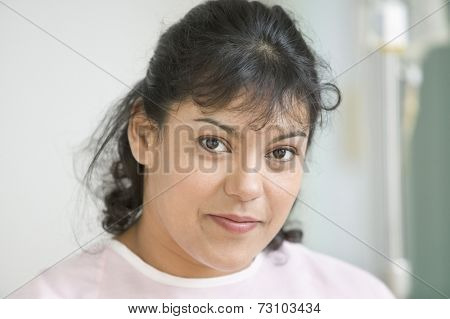Close up of mid adult woman smiling