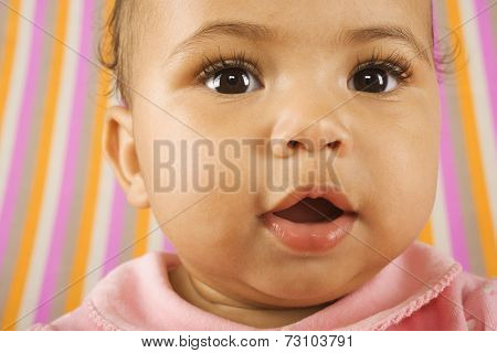 Close-up of baby girl's face