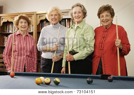 Elderly women shooting pool