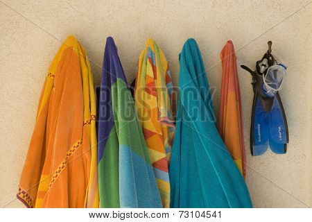 Still life of beach towels on hooks
