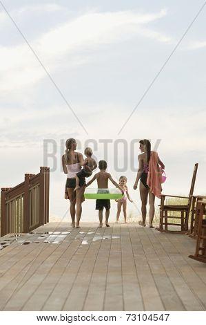Family walking towards the beach