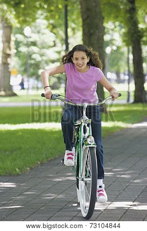 Young girl riding a bike