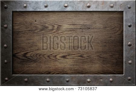 old metal frame over wooden plate