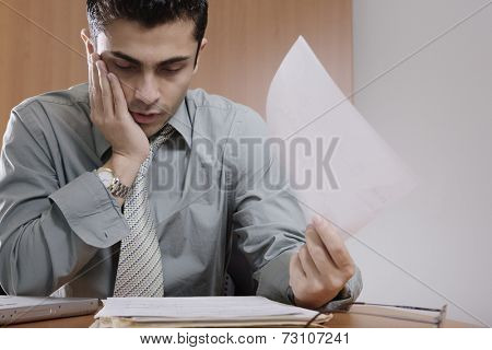 Businessman shuffling through papers