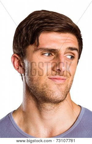 Male model posing looking away on white background
