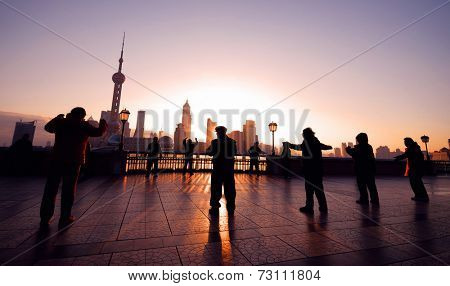 Exercising at sunrise in Shanghai.