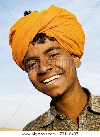 Indigenous Indian boy smiling at the camera.