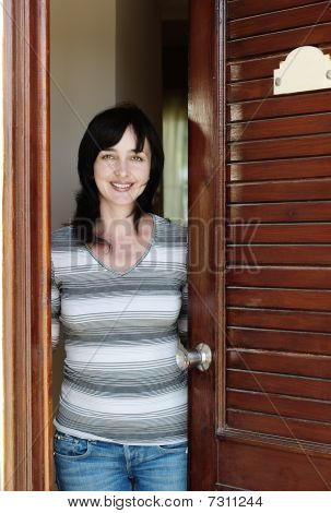 Beautiful Woman Welcomes At The Door