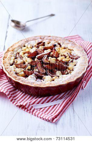 Shortcrust plum tart with coconut crumble