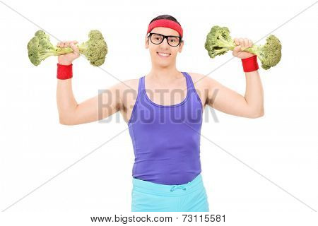 Nerdy guy exercising with two broccoli dumbbells isolated on white background