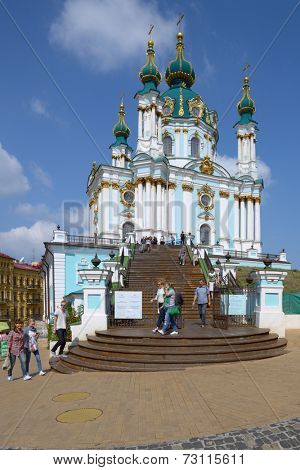 KIEV, UKRAINE - SEPTEMBER 1, 2013: Tourists near the St. Andrew's church in a sunny day. The church was built in 1747 by design of Bartolomeo Rastrelli