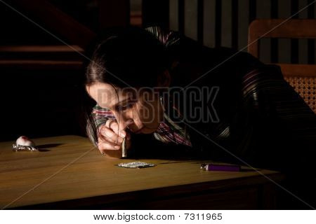 Woman Snorting Cocaine Or Heroin