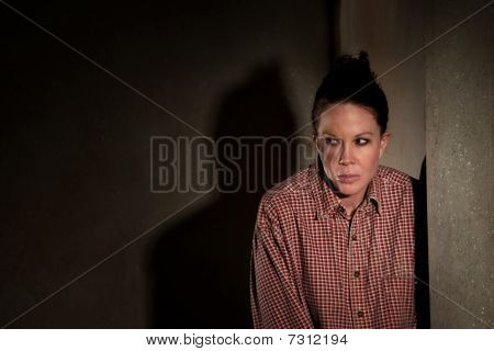 Frightened Woman In Hallway