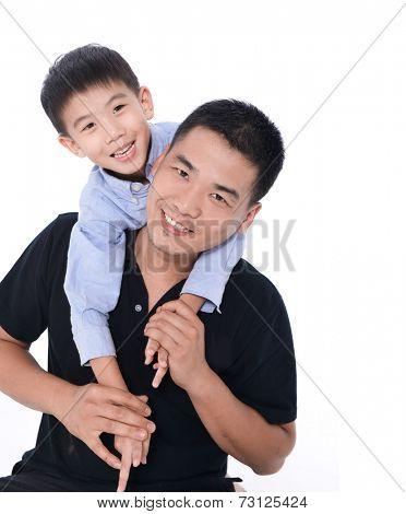 Man giving boy piggy back ride against