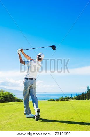 Golfer Hitting Ball with Club on Beautiful Golf Course
