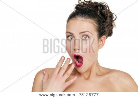 Surprised woman with opened mouth and big eyes holding hands the face and looking happy isolated on white background
