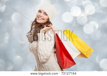 Shopping happy woman holding bags. Winter sales.