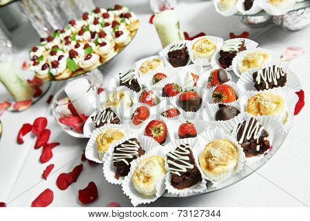 catering service sweets strawberries with chocolate at party