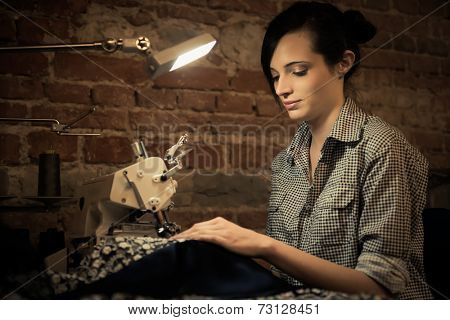 Young woman working on sewing machine