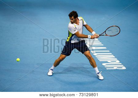 SEPTEMBER 26, 2014 - KUALA LUMPUR, MALAYSIA: Pablo Andujar of Spain prepares to play a backhand return in his match at the Malaysian Open Tennis 2014. This event is an ATP sanctioned tournament.