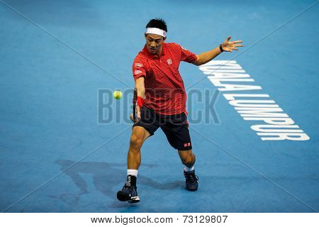 SEPTEMBER 26, 2014 - KUALA LUMPUR, MALAYSIA: Kei Nishikori of Japan makes a backhand return in his match at the Malaysian Open Tennis 2014. This event is an ATP sanctioned tournament.